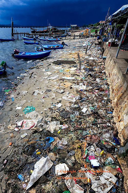 Disgusting: A disgusting level of pollution lines the sandy shoreline adjacent to the market at Koh Kong Cambodia.