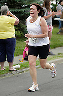Middletown, New York - A runners races to the finish line in the 15th annual Ruthie Dino Marshall 5K Run and Fun Walk hosted by the Middletown YMCA on Sunday, June 5, 2011.