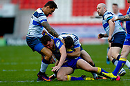 Doncaster RLFC loose forward Brandon Wilkinson (26) is tackled during the Challenge Cup 2018 match between Doncaster and Featherstone Rovers at the Keepmoat Stadium, Doncaster, England on 22 April 2018. Picture by Simon Davies.