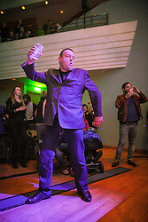 """© Licensed to London News Pictures . 05/02/2016 . Manchester , UK . Members of the audience dancing . """" Hacienda Classical """" debut at the Bridgewater Hall . The 70 piece Manchester Camerata and performers including New Order's Peter Hook , Shaun Ryder , Rowetta Idah , Bez and Hacienda DJs Graeme Park and Mike Pickering mixing live compositions . Photo credit : Joel Goodman/LNP"""