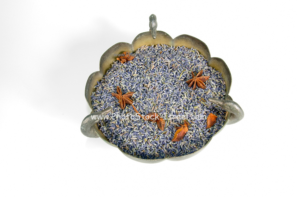 Dried Lavender petals and Star anise in a silver bowl for fragrance Cutout of a on white background