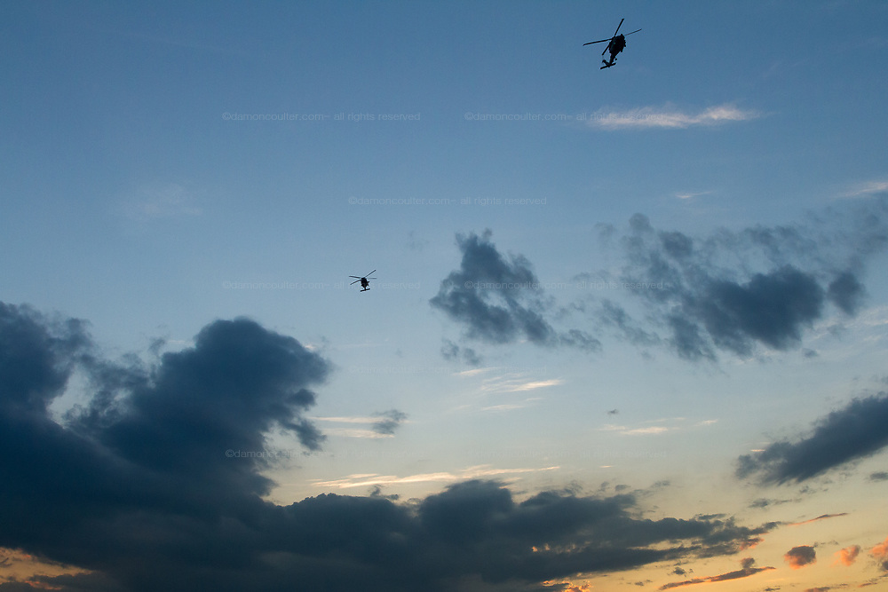 Two Sikorsky UH-60 Black Hawk helicopters fly low near Atsugi  airbase in Yamato, Kanagawa, Japan. Thursday August 9th 2018
