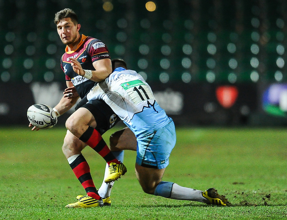 Dragons' Carl Meyer is tackled by Glasgow Warriors' Rory Hughes<br /> <br /> Photographer Craig Thomas/CameraSport<br /> <br /> Rugby Union - Guinness PRO12 Round 16 - Newport Gwent Dragons v Glasgow Warriors - Thursday 25th February 2016 - Rodney Parade - Newport<br /> <br /> © CameraSport - 43 Linden Ave. Countesthorpe. Leicester. England. LE8 5PG - Tel: +44 (0) 116 277 4147 - admin@camerasport.com - www.camerasport.com
