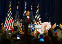 Donald J. Trump speaks to the crowd at Laconia Middle School. (Karen Bobotas/for the Laconia Daily Sun)