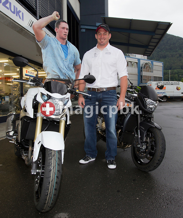 Swiss wrestling star Philipp LAIMBACHER of Switzerland is pictured with a cardboard figure of Kilian WENGER, the current king of the Swiss national sport of Schwingen (swiss wrestling) on his motorbike in Siebnen, Switzerland, Friday, May 27, 2011. (Photo by Patrick B. Kraemer / MAGICPBK)