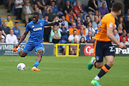 AFC Wimbledon defender Deji Oshilaja (4) passing the ball during the EFL Sky Bet League 1 match between AFC Wimbledon and Oldham Athletic at the Cherry Red Records Stadium, Kingston, England on 21 April 2018. Picture by Matthew Redman.