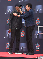 Lionel Richie Handprints and Footprints at the Lionel Richie Hand and Footprints Ceremony at the TCL Chinese Theatre on March 7, 2018 in Hollywood, Ca. © Janet Gough / AFF-USA.COM. 07 Mar 2018 Pictured: Samuel L. Jackson and Lionel Richie. Photo credit: MEGA TheMegaAgency.com +1 888 505 6342