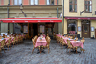 Stockholm, Sweden -- July 16, 2019. An outdoor restaurant with red and white checkered table cloths in Old Town Stockholm.