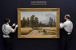 """© Licensed to London News Pictures. 03/06/2016. London, UK. Sotheby's staff hang Ivan Shiskin's """"At the edge of the pine forest"""" (est. GBP 500,000-700,000), at a preview of Sotheby's Russian and contemporary central and eastern European art sale which takes place in London on 7 June. Photo credit : Stephen Chung/LNP"""
