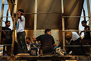 A migrant group waits the train departure in Arriaga, Mexico, April 21, 2013.