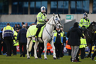 Police horses on the pitch to control the crowd after full time. The Emirates FA Cup 5th round match, Millwall v Leicester City at The Den in London on Saturday 18th February 2017.<br /> pic by John Patrick Fletcher, Andrew Orchard sports photography.