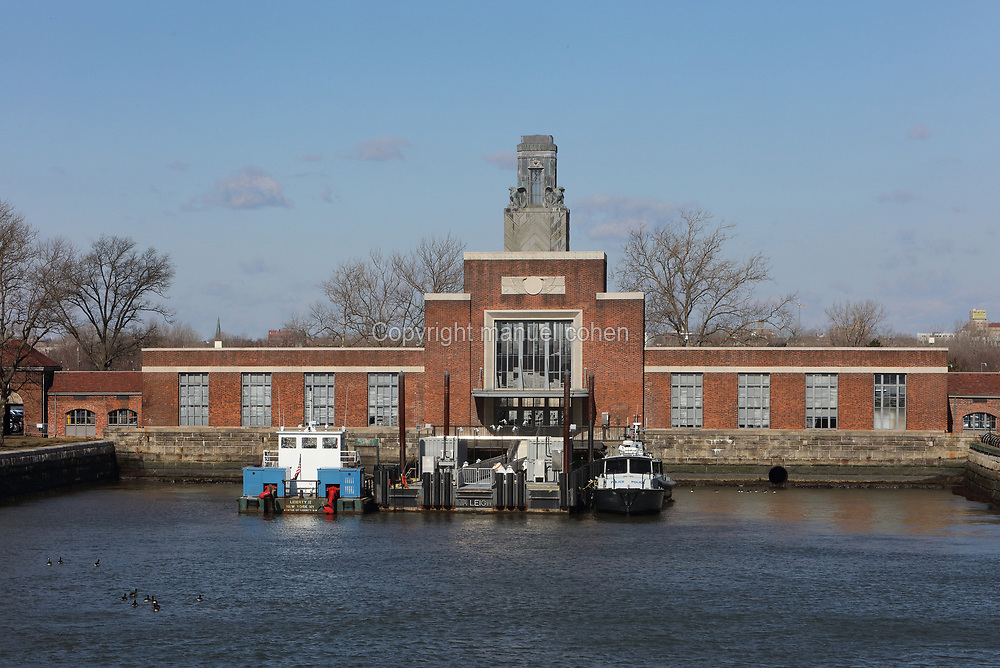 Ferry dock and terminal building, on Ellis Island, the immigration processing centre for the United States from 1892 to 1954, at the mouth of the Hudson river in New York City, NY, USA. The ferry building was built in 1936 in Moderne style, contains a US Customs office, lunchroom and restrooms, and was restored in 2007. Picture by Manuel Cohen