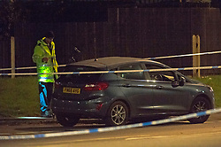 © Licensed to London News Pictures. 13/04/2019.<br /> Orpington, UK. Police investigation officer with the car. A child is in a critical condition in hospital after being hit by a blue car in Orpington, South East London tonight. Traffic police are on scene with cordons in place on Court Road A224. Photo credit: Grant Falvey/LNP