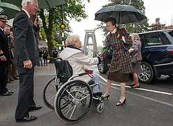 © Licensed to London News Pictures. 01/06/2015. Bristol, UK.  HRH the Princess Royal Princess Anne greets the Lord-Leiutentant  of Somerset Mrs Annie Maw (in wheelchair) as she arrives to open the new visitor centre for the Clifton Suspension Bridge.  The bridge is 150 years old and was designed by the engineer Isambard Kingdom Brunel.  Photo credit : Simon Chapman/LNP