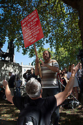Pro-leave protesters arguing amongst themselves outside The Supreme Court as the first day of the hearing to rule on the legality of suspending or proroguing Parliament begins on September 17th 2019 in London, United Kingdom. The ruling will be made by 11 judges in the coming days to determine if the action of Prime Minister Boris Johnson to suspend parliament and his advice to do so given to the Queen was unlawful.