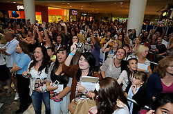 """© Licensed to London News Pictures. 15/09/2011.Lakeside,Essex, UK.One Direction at Lakeside,Essex to sign copies of their new book """"Dare to Dream"""".  Liam, Harry, Zayn, Louis and Niall showed off the new book at   Lakeside's Central Atrium today (15.09.2011).Fans going crazy.Photo credit : Grant Falvey/LNP"""