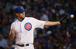 June 7, 2017 - Chicago, IL, USA - Chicago Cubs starting pitcher John Lackey retrieves the ball after giving up a home run to the Miami Marlins' Marcell Ozuna in the fifth inning at Wrigley Field in Chicago on Wednesday, June 7, 2017. (Credit Image: © John J. Kim/TNS via ZUMA Wire)