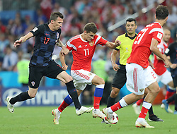 SOCHI, July 7, 2018  Roman Zobnin (2nd L) of Russia vies with Mario Mandzukic (1st L) of Croatia during the 2018 FIFA World Cup quarter-final match between Russia and Croatia in Sochi, Russia, July 7, 2018. (Credit Image: © Yang Lei/Xinhua via ZUMA Wire)