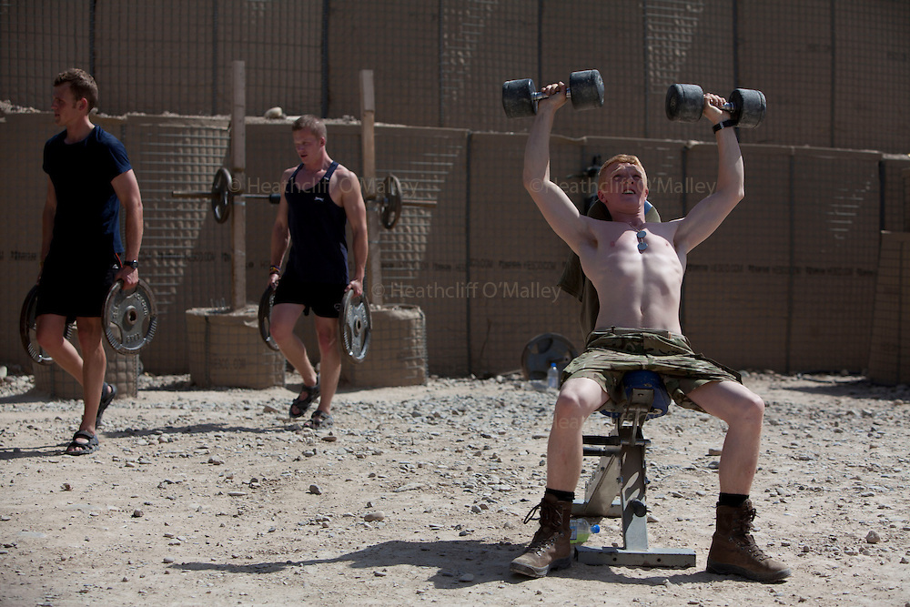 Mcc0053988 . Daily Telegraph<br /> <br /> DT News<br /> <br /> Soldiers working out at the gym in Sterga II Observation Post, the last remaining British military base outside of Camp Bastion .<br /> <br /> Helmand 31 March 2014