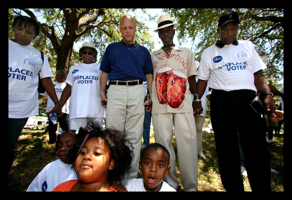 May 20th, 2006. New Orleans, Louisiana. The IAF Network of Katrina Survivors organised a rally outside city hall for displaced voters who were bussed in from Houston and other cities to vote. Mayoral challenger Louisiana Lieutenant Governor Mitch Landrieu works the crowd and stops for prayer on voting day as the group demands answers to their many questions.