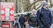 12th, March, 2021. Cheltenham, England. Members of the public walk through the town centre wearing masks.