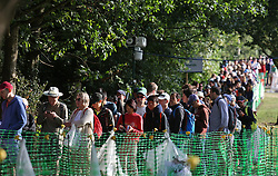 People queuing in Wimbledon Park Golf Club on day three of the Wimbledon Championships at the All England Lawn Tennis and Croquet Club, Wimbledon.