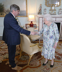RETRANSMITTED FOR THOSE NEEDING Queen Elizabeth II receives Simon Armitage to present him with The Queen's Gold Medal for Poetry upon his appointment as Poet Laureate during an audience at Buckingham Palace, London.