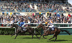 Khaadem (left) riden by Jim Crowley wins the British Stallion Studs EBF Conditions Stakes with Swissterious (right) taking 2nd place, during day one of the 2018 William Hill St Leger Festival at Doncaster Racecourse, Doncaster.