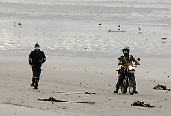 SOUTH AFRICA - Cape Town - 05 May 2020 - Coronavirus Lockdown - A peaceful protest by surfers appealing to be allowed to surf across the cape saw many of them being arrested on Tuesday morning. A municipal worker is escorted from Muizenberg beach after he is seen running on the beach during a work break. Picture: Tracey Adams/African News Agency (ANA)
