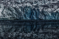 Captivating glacier reveals its true state as shattered pieces in the reflection of calm Arctic waters. Similarly, nature reflects and reveals truth about us regardless of our consistent efforts to thwart it. We pretend Mother Earth is healthy, while the truth is we have systematically shattered her.