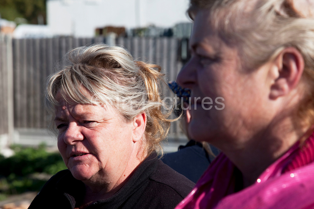 Mary McCarthy (l) stands with her sister Margaret at Dale Farm site prior to eviction. Riot police and bailiffs were present on 20th October 2011, as the site was cleared of the last protesters chained to barricades. Dale Farm is part of a Romany Gypsy and Irish Traveller site in Crays Hill, Essex, UK. <br /> <br /> Senior resident Kathleen McCarthy said she now wished to leave, once obstacles are removed, and the majority of residents are expected to join her. Most plan to relocate to Oak Road, on the neighbouring legal site.<br /> <br /> Dale Farm housed over 1,000 people, the largest Traveller concentration in the UK. The whole of the site is owned by residents and is located within the Green Belt. It is in two parts: in one, residents constructed buildings with planning permission to do so; in the other, residents were refused planning permission due to the green belt policy, and built on the site anyway.