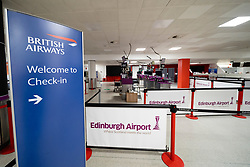 Edinburgh, Scotland, UK. 27 March, 2020. Interior views of a deserted Edinburgh Airport during the coronavirus pandemic. With very few flights during the current Covid-19 crisis passengers are scarce in the terminal building. British Airways check in is deserted. Iain Masterton/Alamy Live News