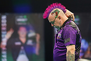 Peter Wright appears injured during the PDC Premier League Darts Night 11 at Marshall Arena, Milton Keynes, United Kingdom on 6 May 2021.