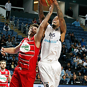 Efes Pilsen's Lawrence ROBERTS (R) and Pinar Karsiyaka's Furkan ALDEMIR (L) during their Turkish Basketball Legague Play-Off qualifying first match Efes Pilsen between Pinar Karsiyaka at the Sinan Erdem Arena in Istanbul Turkey on Wednesday 11 May 2011. Photo by TURKPIX
