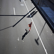 Eric MacKnight, Ballston Lake, New York,  finishing third in the ING Hartford Marathon, Bushnell Park, Hartford. Connecticut. USA. Hartford, Connecticut, USA. 12th October 2013. Photo Tim Clayton
