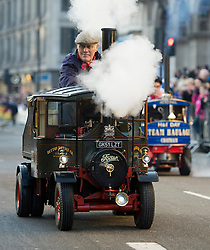 © London News Pictures. 01/01/2013. London, UK.  Miniature Steamers fro Charity take part in the 2012 New Years Parade through the centre London on January 1st, 2013. Photo credit : Ben Cawthra/LNP