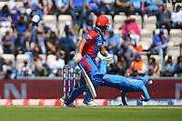 Cricket - 2019 ICC Cricket World Cup - Group Stage: India vs. Afghanistan<br /> <br /> Hazratullah Zazai of Afghanistan looks on as a diving Virat Kohli of India fails to get close to possible catch during the cricket world cup match at the Hampshire Bowl, Southampton.<br /> <br /> COLORSPORT/SHAUN BOGGUST