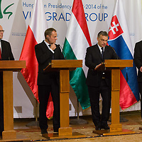 Bohuslav Sobotka (L) Prime Minister of Czech Republic, Donald Tusk (2nd L) Prime Minister of Poland, Viktor Orban (2nd R) Prime Minister of Hungary and Robert Fico (R) Prime Minister of Slovakia talk during a press conference after the special meeting of the prime ministers of the Visegrad 4 Group in Budapest, Hungary on January 29, 2014. ATTILA VOLGYI