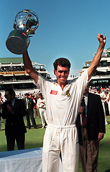 South African captain Hansie Cronje raises the Test Series Trophy after defeating England in the 5th Test at Newlands, Cape Town.