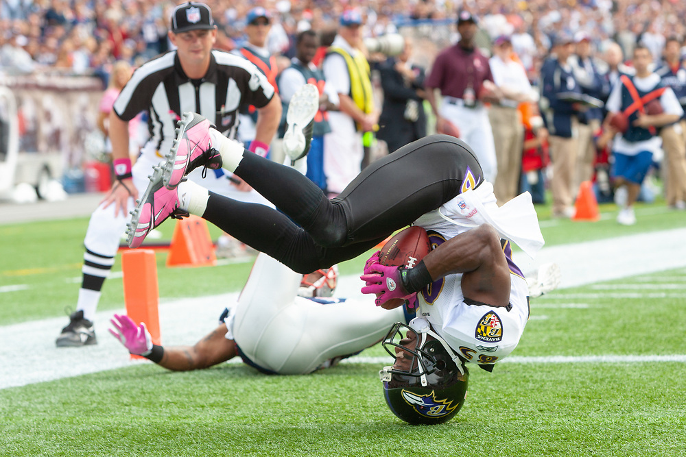 Baltimore Ravens wide receiver Derek Mason standing on his head while hauling in a touchdown grab during a game in Foxboro.