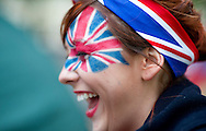 Royal enthusiast  from Bedfordshire poses at the junction of the Mall and  Horse Guards Road for the Royal Wedding in London Friday, April, 29, 2011. (AP Photo/Bogdan Maran)