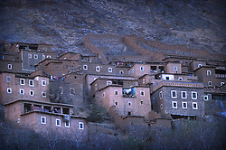 Houses high on a mountain side overlooking Imlil, High Atlas, Morocco.