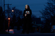 """COLONIE, NY - MARCH 31: Patty Farrell stands with a photo of her daughter, Laree Farrell-Lincoln, near her home in Colonie, N.Y., Thursday, March 31, 2016. Farrell-Lincoln, 18, fatally overdosed on heroin in 2013, just five days before her 19th birthday. The New York state Senate in June passed a bill – named """"Laree's Law"""" after Farrell-Lincoln, that would enable prosecutors to charge heroin dealers with homicide when their product can be linked to a death."""