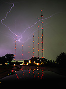 Lightning sparks the night sky among antenna towers in Austin, Texas.