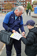 AFC Wimbledon manager Glyn Hodges arriving and signing autographs during the EFL Sky Bet League 1 match between AFC Wimbledon and Lincoln City at the Cherry Red Records Stadium, Kingston, England on 2 November 2019.