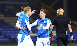 Sammie Szmodics of Peterborough United congratulates Jack Taylor (hidden) after scoring the opening goal - Mandatory by-line: Joe Dent/JMP - 28/11/2020 - FOOTBALL - Weston Homes Stadium - Peterborough, England - Peterborough United v Chorley - Emirates FA Cup second round