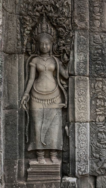 Bas-relief carving of an Aspara Dancer (heavenly nymph) in Baphuon Temple, Siem Reap Cambodia