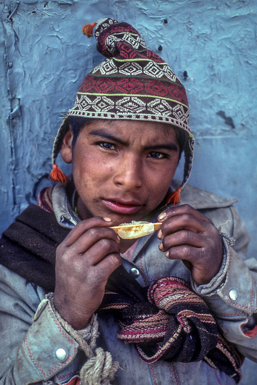 Local boy eating iced lolly, Oruro, Bolivia
