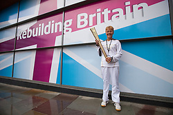© Licensed to London News Pictures. 02/10/2012. Manchester, UK . Olympic Torch Bearer , Sue Blaylock , from Wythenshawe in Manchester , who appeared on stage during the Team Great Britain session at the Labour Party Conference Day 3 at Manchester Central . Photo credit : Joel Goodman/LNP
