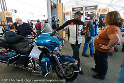 Checking out a new Project Rushmore bike at the Harley-Davidson display during Daytona Bike Week, FL, USA. March 8, 2014.  Photography ©2014 Michael Lichter.